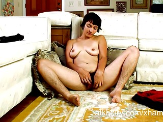 Brunette with very hairy legs masturbates her hairy cunt