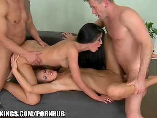 Two pretty yoga fans riding cocks in amazing foursome