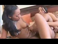 Two sexy black-skinned chicks stimulate their yummy pussies using small dildo