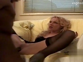 Nice blonde lady with small tits gets seduced by dark-skinned man with large penis