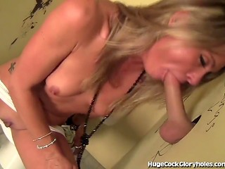 Small titted slut sucks stranger's dick with pleasure through a gloryhole