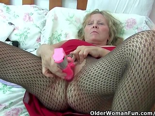 Granny wants to get entirely satisfied and masturbates with a huge vibrator in her bedroom