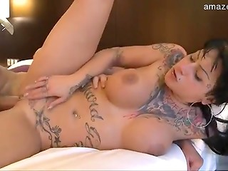 Tattooed brunette MILF gives BJ outside then gets banged in hotel room