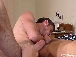 Two well-built gay guys tenderly kissing, stroking each other and then fucking