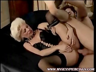 Mature blonde in stockings and corset gets her ass fucked, brunette watches and masturbates