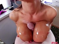 Nasty slut Lisa Ann giving a titjob with her big oiled up breasts 8
