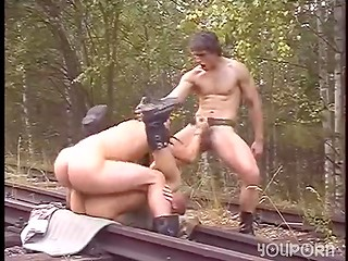 Horny foresters have hot sex on the railway in the outdoor threesome scene