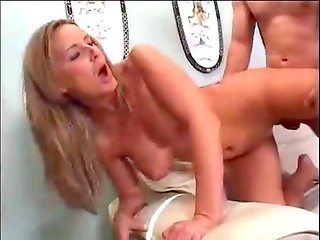 MILF with pretty tits gets cream on her face