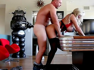 Busty blonde barmaid having sex with tall and strong man