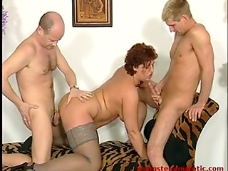 Deep fisting and sex with two men make horny MILF happy