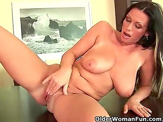 Older woman having fun with her shaved pussy on the table