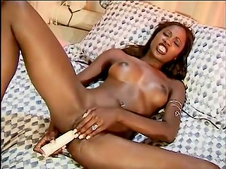 Slender Ebony girl takes a dildo in her asshole in bedroom solo masturbation action