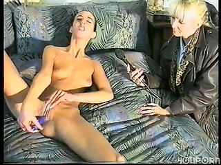 Skinny German brunette bitch gets completely naked and plunges blue candle in her pierced pussy