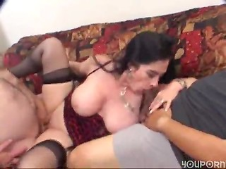 Mature bitch with really huge boobies is happy to satisfy two cocks with her wet holes