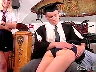 Man pushes forward two sexy MILF's attractive butts in the music classroom