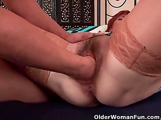 Hairy redhead whore in stockings gets her twat deep fisted