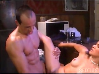 Two muscled fellows fucked hot brunette in various positions right on the bar
