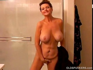 Awesome MILF with beautiful big boobs and pierced nipples came in the bathroom to soap and rub her pussy