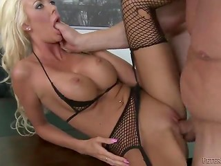 Stunning beautiful blonde in torn stockings takes knob up her ass