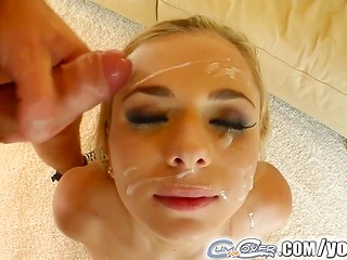 Blonde babe sucks dicks then gets cum reward on her pretty face