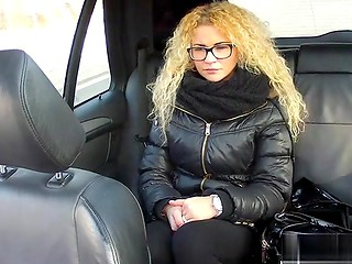 Curly-haired blonde babe with sexy glasses sucks taxi driver's cock and gets banged in the car