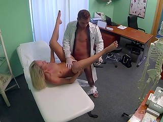 Beautiful blonde chick was fingered by a doctor at the medical examination