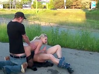 Slutty blonde chick in sexy stockings gets banged by two fuckers near the public road