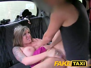 Exciting FakeTaxi action with busty blonde bombshell and lucky taxi driver