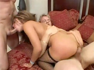 Super hot and horny babe in sexy fishnet stockings satisfies three powerful cocks in the hardcore scene