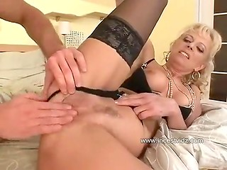 Mature blonde woman in hot stockings gets her asshole gaped by young man with nice dick