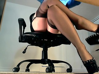 Hot camera was installed under sexy secretary's desk and presents us a lot of sweet moments