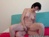 Short-haired mature lady makes dick wet and rides it