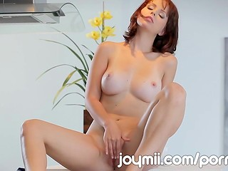 Redhead hottie with exciting forms presents her beautiful body with perfect boobs in the solo scene