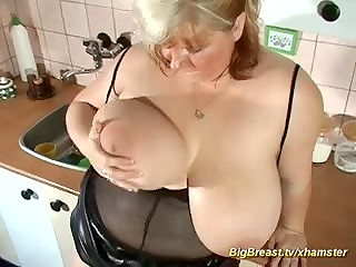 Blonde BBW women plays with her giant natural tits and rubs shaved pussy with a toy