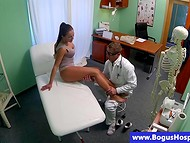 Horny doctor feels up long-legged brunette girl's treasures at the medical examination