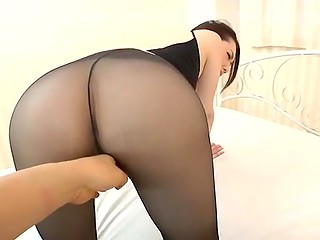 Japanese girl in black ragged tights shows off her pussy