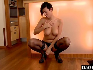 Bewitching short-haired brunette babe with top-class boobs masturbates in the kitchen
