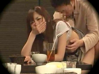 Shameless Japanese babe making love to her boyfriend in the cafe while others are eating