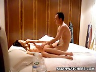 Enterprising amateur Asian couple fucking in the hotel room