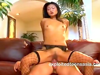 Hot natural bodied Asian chick Lucy Lee takes it anally and gets massive cumshot in her slanted eye