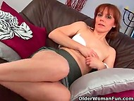 Mature redhead gently touches her pussy through white panties