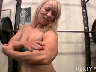 Muscular blonde's workout in gym
