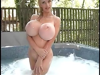 Norwegian stunner Alena Snow with G-cup huge tits relaxing in outdoor hot tub