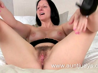 Enjoy the unshaved pussy of slutty brunette MILF named Amber in the solo scene