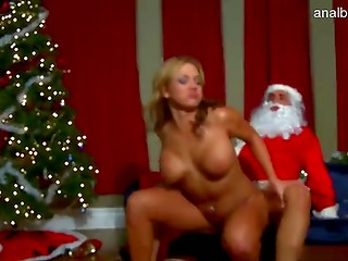 Lucky Santa meets appetizing blonde with a pair of huge tanned melons on the Christmas night
