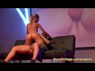Slender blonde bitch sucks and fucks a man on the stage in front of the full hall