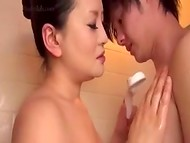 Experienced Asian MILF giving a first-class blowjob to her young sexy friend 8