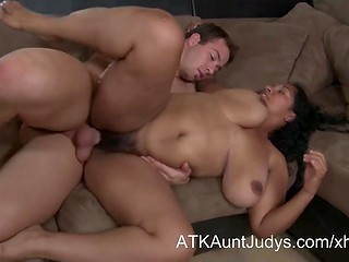 Chubby Ebony shakes her huge natural tits making interracial love to the younger white man