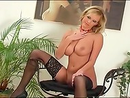 Blonde bombshell in black stockings with big melons showing her sexy body moving slowly