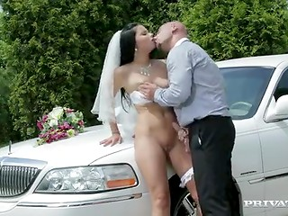 Gorgeous brunette bride fucks the limousine driver on the way to the wedding